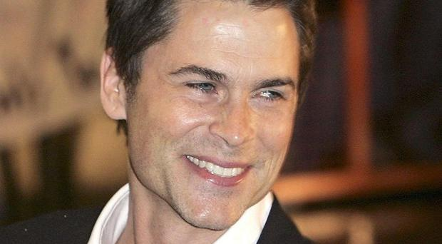 Rob Lowe said it can be tough being good-looking