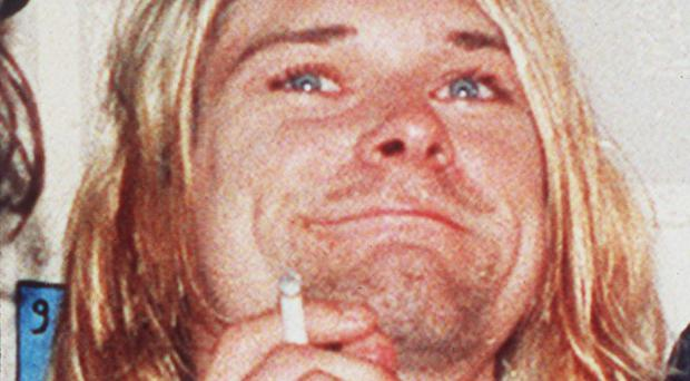 An expert on Kurt Cobain said the singer did not pen a note mocking his wedding vows to fellow musician Courtney Love