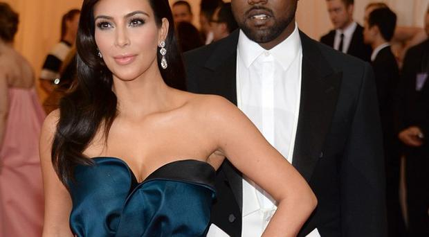 Kim Kardashian and Kanye West appeared on the cover of Vogue