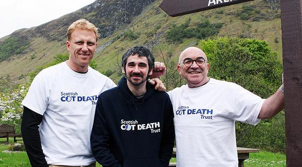 Kevin McKidd, Iain Robertson and Guy Cowan on a charity climb of Ben Nevis in Scotland for the Scottish Cot Death Trust