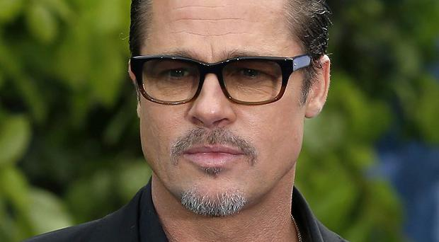 I got my grandfather's shotgun when I was in kindergarten: Brad Pitt
