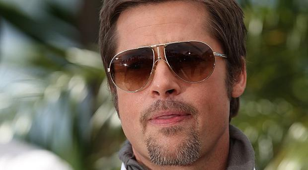 A man arrested after jostling with Brad Pitt on a red carpet claims he was trying to give the actor a hug