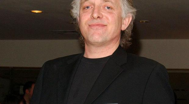 Rik Mayall may have suffered a seizure, according to his friend Peter Richardson