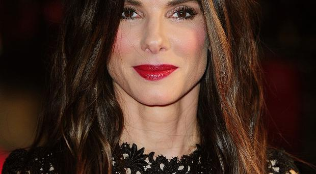 A man has been charged with breaking in to Sandra Bullock's house while she was at home