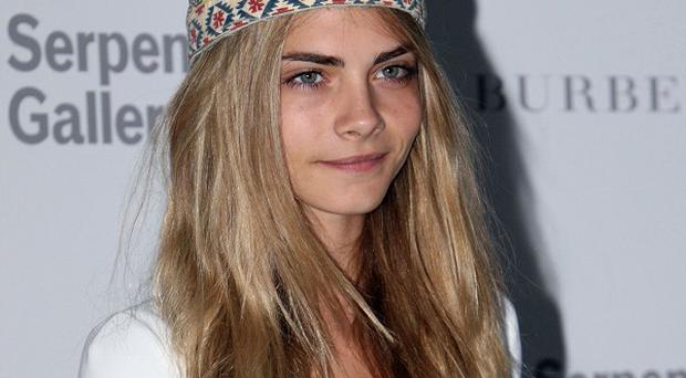 Cara Delevingne has been posing naked again