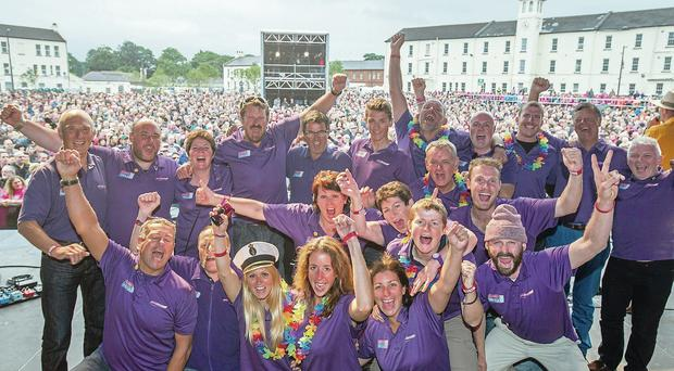 The crew of the winning clipper, Derry-Londonderry-Doire, receive a rapturous welcome from the crowd at Ebrington Square before The Beach Boys