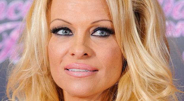 Pamela Anderson is heading for divorce again, according to reports