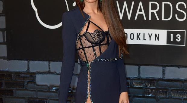 Selena Gomez has challenged an online troll who made a comment about cancer