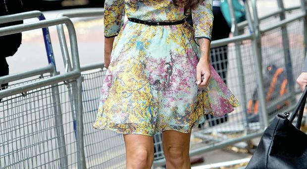 Tulisa arrives at Southwark Crown Court in London yesterday to face drug charges