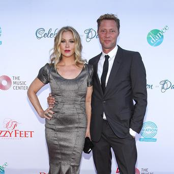 Christina Applegate and husband Martyn LeNoble (AP)