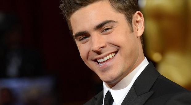 Zac Efron has been named hottest hunk of 2014 by Heat magazine readers