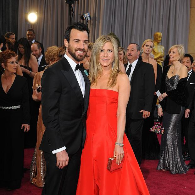 Justin Theroux says he has had to get used to being in the celebrity spotlight with Jennifer Aniston