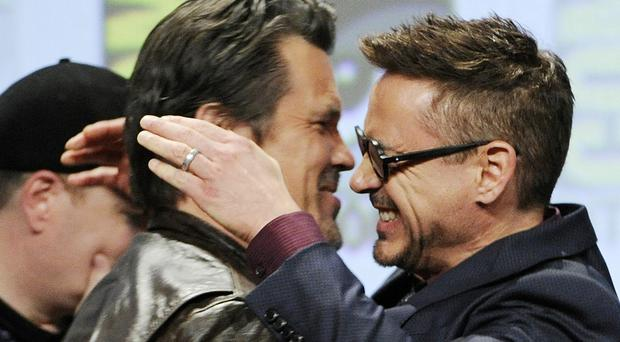 Josh Brolin and Robert Downey Jr embrace at the end of the Marvel panel at Comic-Con International in San Diego