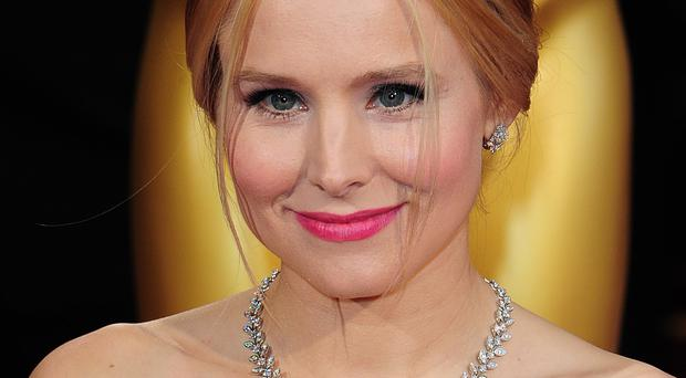 Kristen Bell is performing on stage