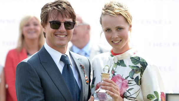 Tom Cruise presented the trophy to supermodel Edie Campbell after winning the Magnolia Cup at Glorious Goodwood