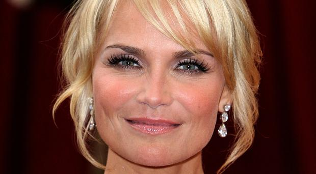 Kristin Chenoweth likes to veg out in front of the TV