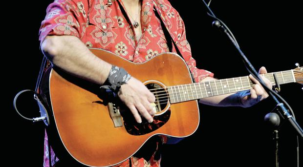 Steve Earle took the stage in the ecclesiastical backdrop of Bangor Abbey