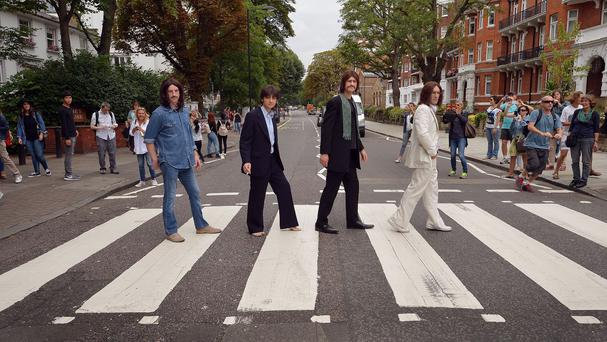 The stars of the West End musical Let It Be recreate the Beatles's famous Abbey Road crossing