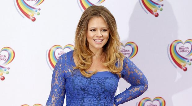 Kimberley Walsh says she would like a video of herself giving birth