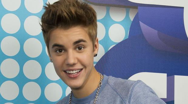Justin Bieber is said to have paid his fine for trying to bring a monkey without papers into Germany