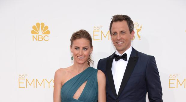 Alexi Ashe and Seth Meyers arrive at the 66th Primetime Emmy Awards at the Nokia Theatre in Los Angeles. (Evan Agostini/Invision for the Television Academy/AP)