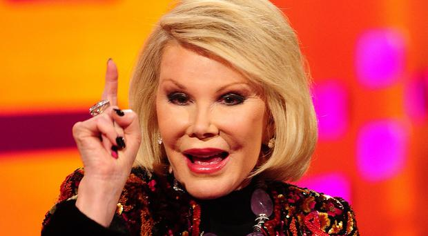 Joan Rivers remains in hospital three days after going into cardiac arrest at a doctor's office.