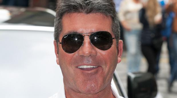 Simon Cowell phones a contender's boss