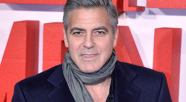 George Clooney is to take a guest role in a Downton Abbey sketch for charity