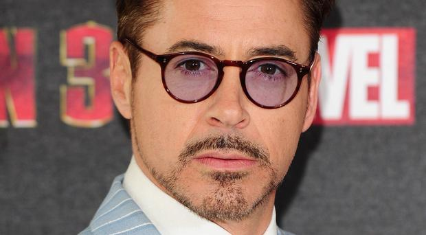 Robert Downey Jr is supporting his son Indio as he completes a drug diversion programme