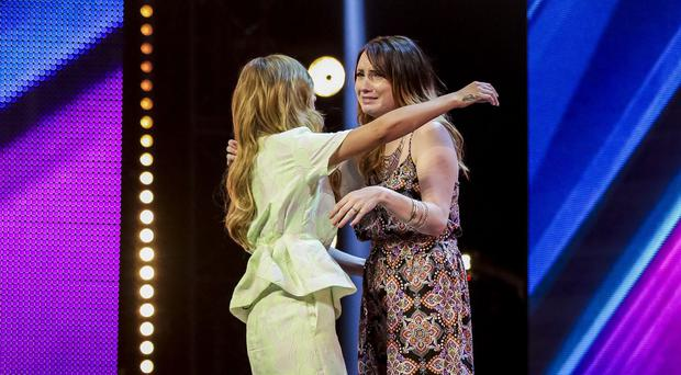Cheryl Fernandez-Versini comforts Amy Connelly on the X Factor (Syco/Thames TV)