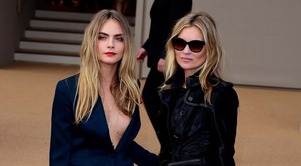 Cara Delevingne and Kate Moss were guests at the Burberry Prorsum catwalk show