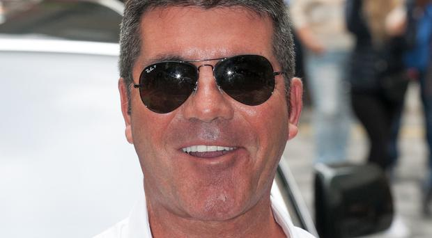 Simon Cowell is planning a festive celebrity competition