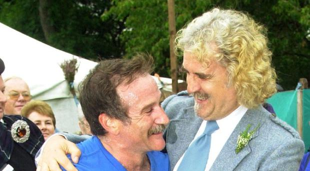 Billy Connolly jokes with his friend Robin Williams after the late star ran the hill race at the Lonach Highland Games in Strathdon, near Balmoral