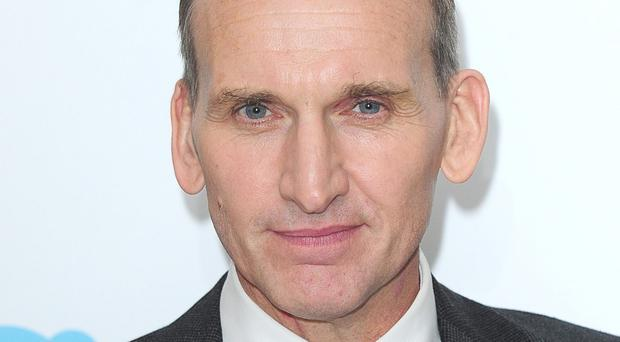 Christopher Eccleston is to receive compensation over alleged phone hacking