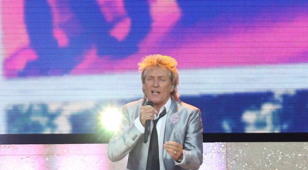 A fan is suing Rod Stewart after a football hit him and broke his nose