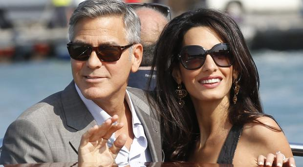 George Clooney and Amal Alamuddin arrive in Venice