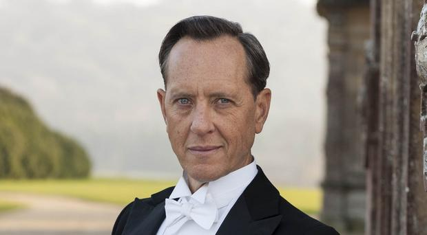 Richard E Grant plays art historian Simon Bricker in Downton Abbey