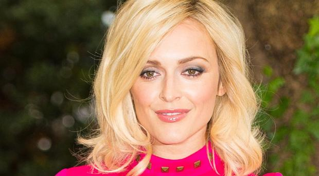Fearne Cotton returned to work to host her Radio One show just four days after her nuptials