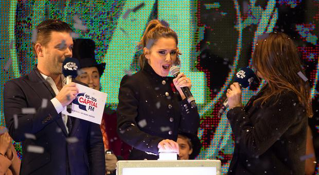 X Factor judge Cheryl Fernandez-Versini with Lisa Snowdon (right)and Dave Berry (left) during the switch on for this year's Oxford Street Christmas lights in central London.
