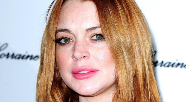 A judge has ended Lindsay Lohan's probation for stealing a necklace