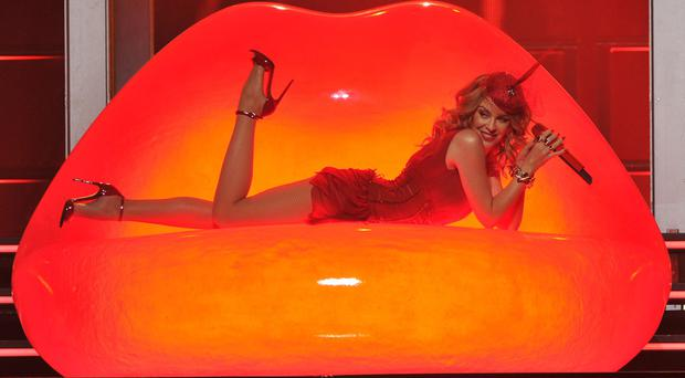 Hot lips: Aussie star Kylie Minogue thrills fans with her music and wardrobe changes