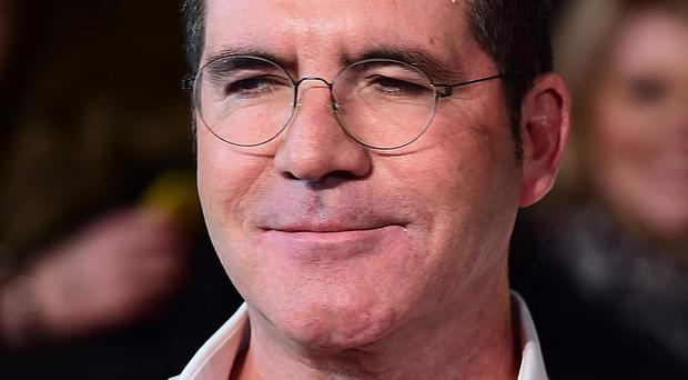 Simon Cowell has apologised for being so grumpy on The X Factor