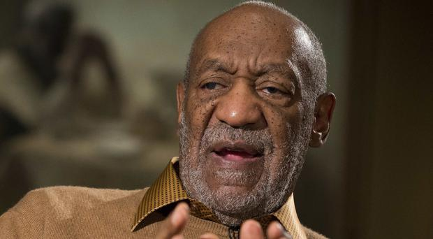 A woman claims entertainer Bill Cosby molested her when she was 15 (AP)