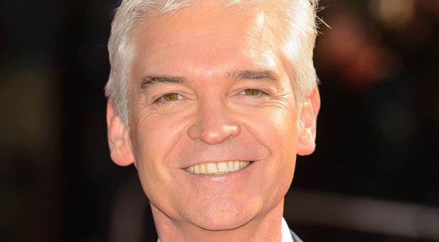 Phillip Schofield has climbed the highest building in western Europe.