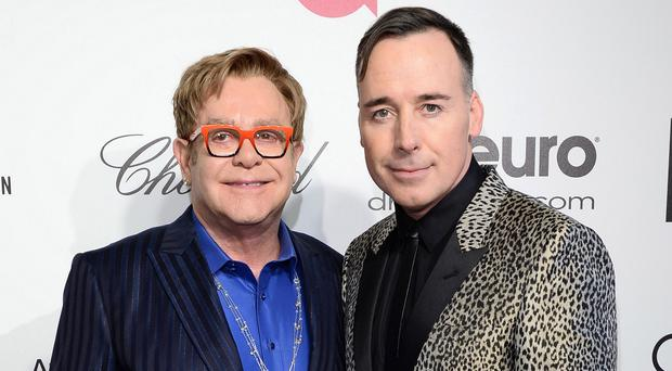Sir Elton John and David Furnish are apparently set to wed