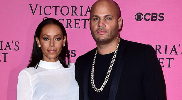 Mel B's husband Stephen Belafonte has denied hitting her