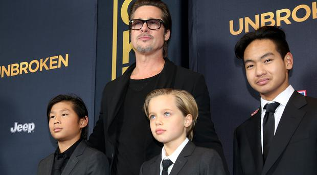 Brad Pitt with his children Pax, Shiloh and Maddox at the Los Angeles premiere of Unbroken