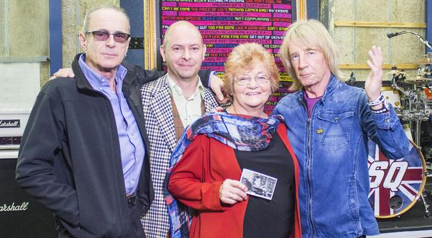 Francis Rossi (far left) and Rick Parfitt (far right) are the unlikely guests on the Antiques Roadshow Christmas special