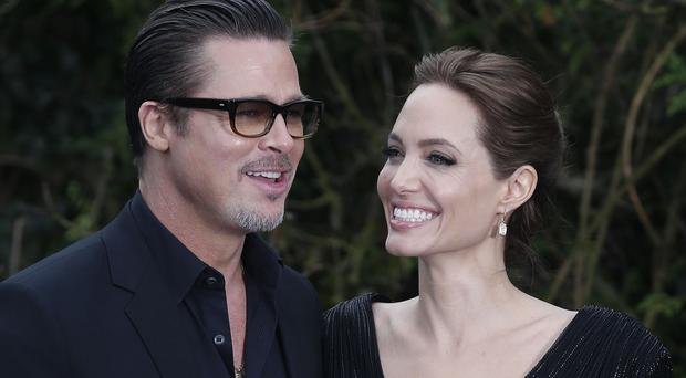 Angelina Jolie says she and Brad Pitt work hard at their marriage