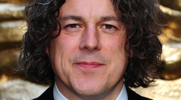 Alan Davies has hit out at TV soaps for 'destroying sitcoms'